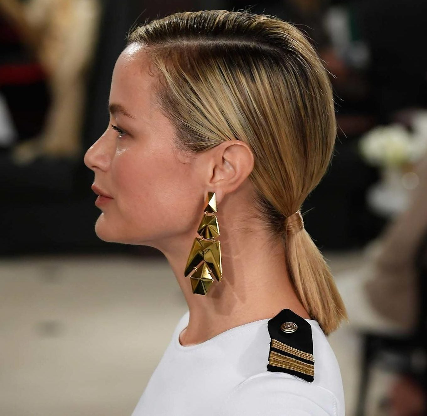 NYFW Catwalk Trends: Woman with short straight blonde hair in a low ponytail.