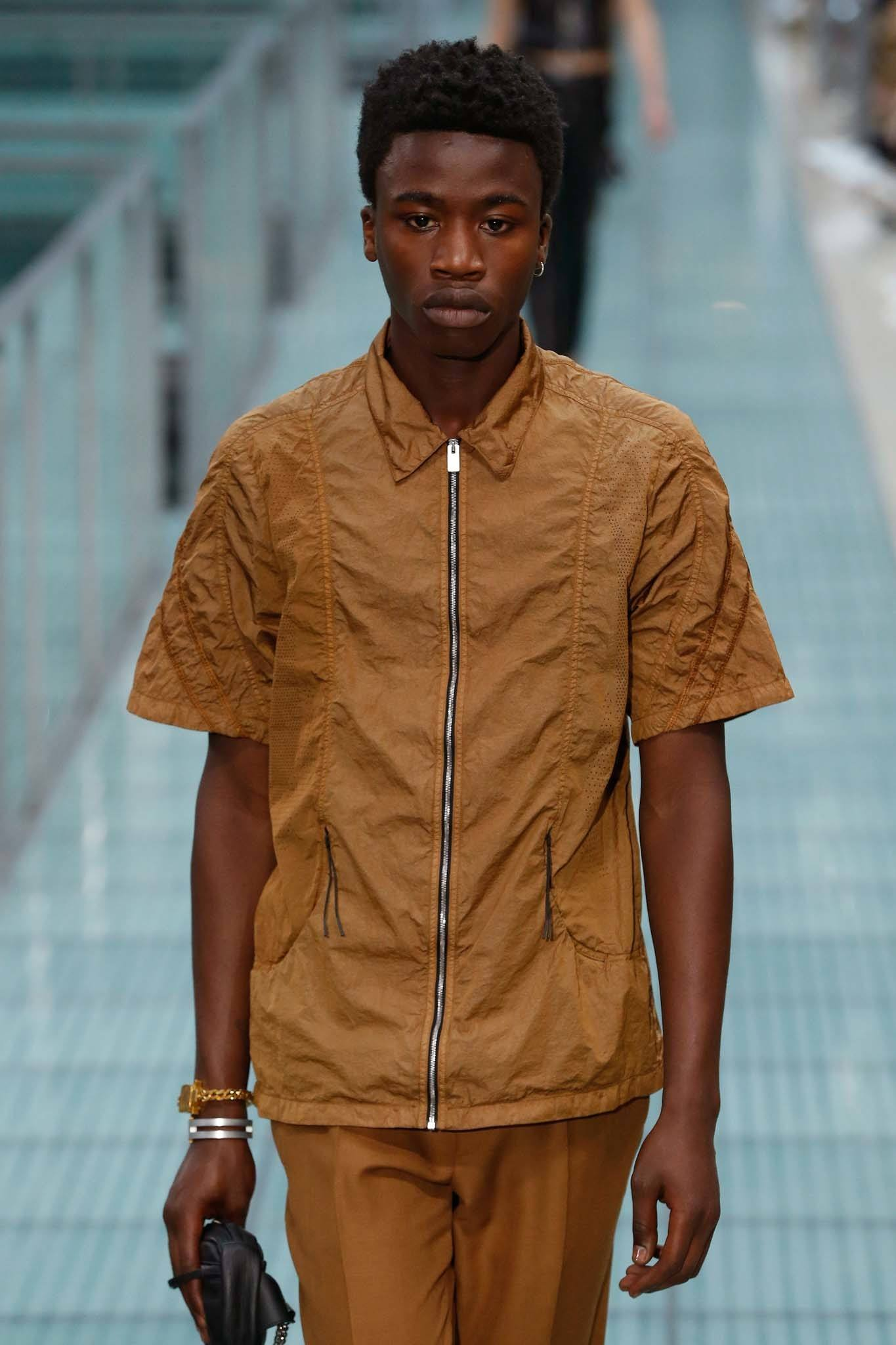 Male runway model with afro high top