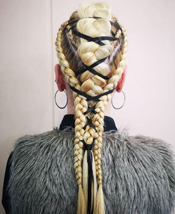 Long blonde hair in a corset braid