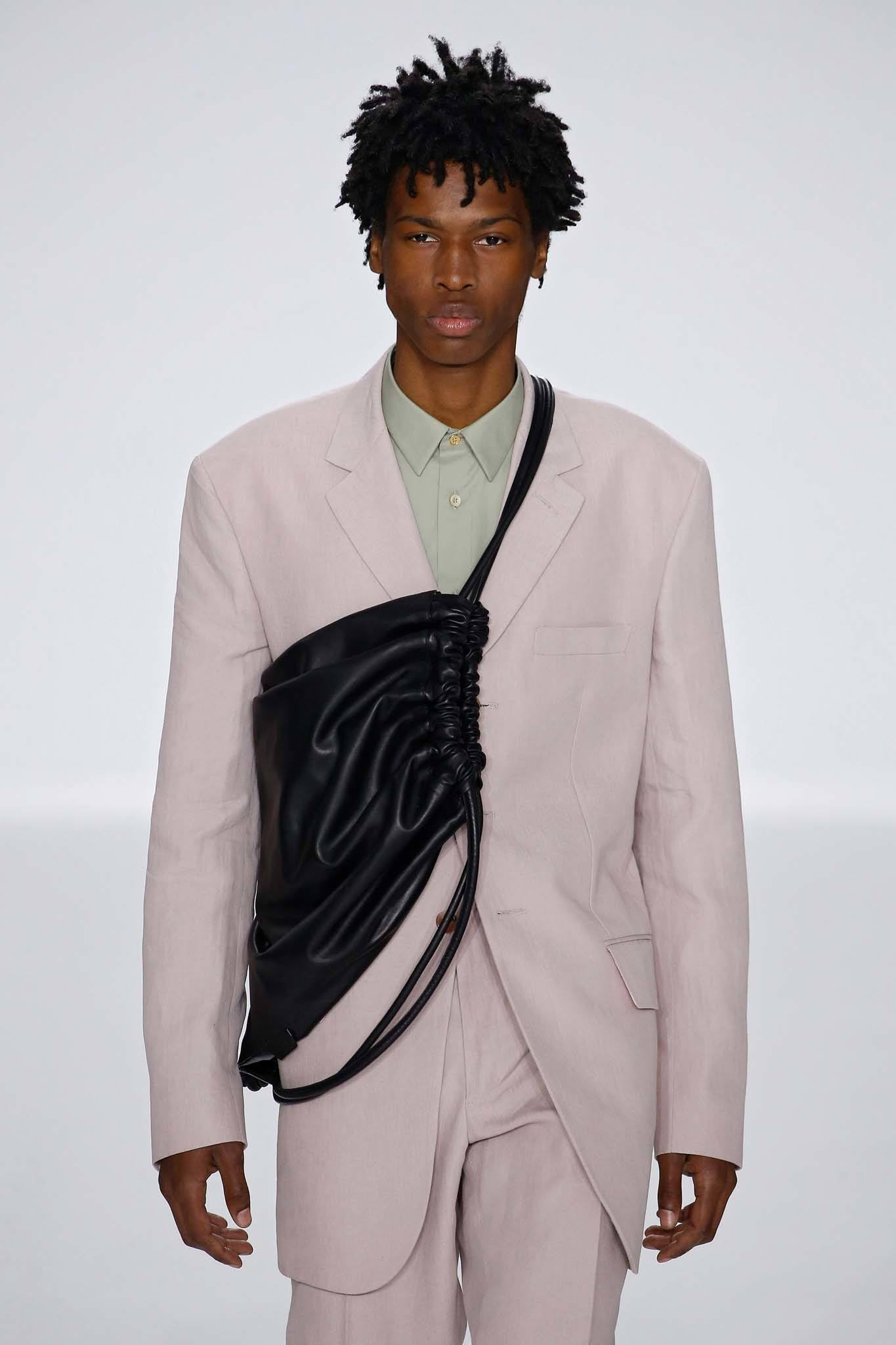 Male runway model with twisted natural hair