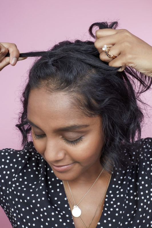 How to braid short hair: Photo of All Things Hair Global Senior Producer Elise doing a half-up Dutch braid on her hair