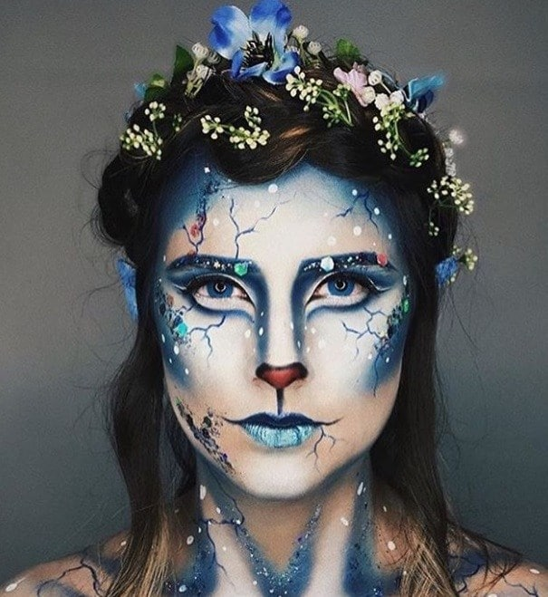 Halloween hair accessories: Woman dressed as woodland creature with half-up crown braids with flowers