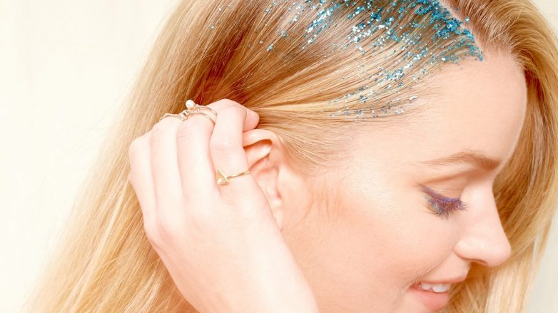 Blonde woman with blue glitter roots