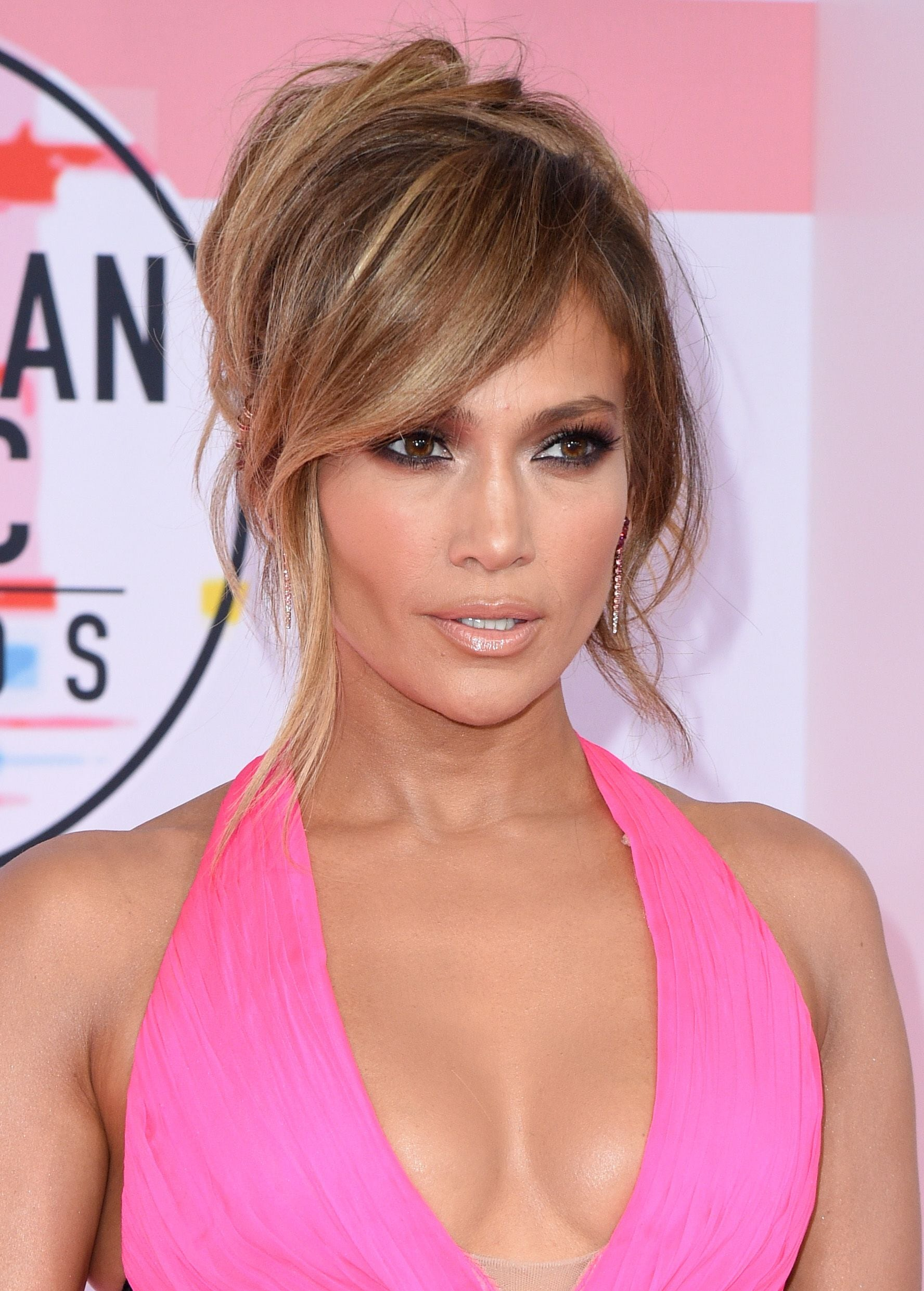 Winter hairstyles 2018: Jennifer Lopez (J-Lo) with a wispy updo with a side swooping fringe