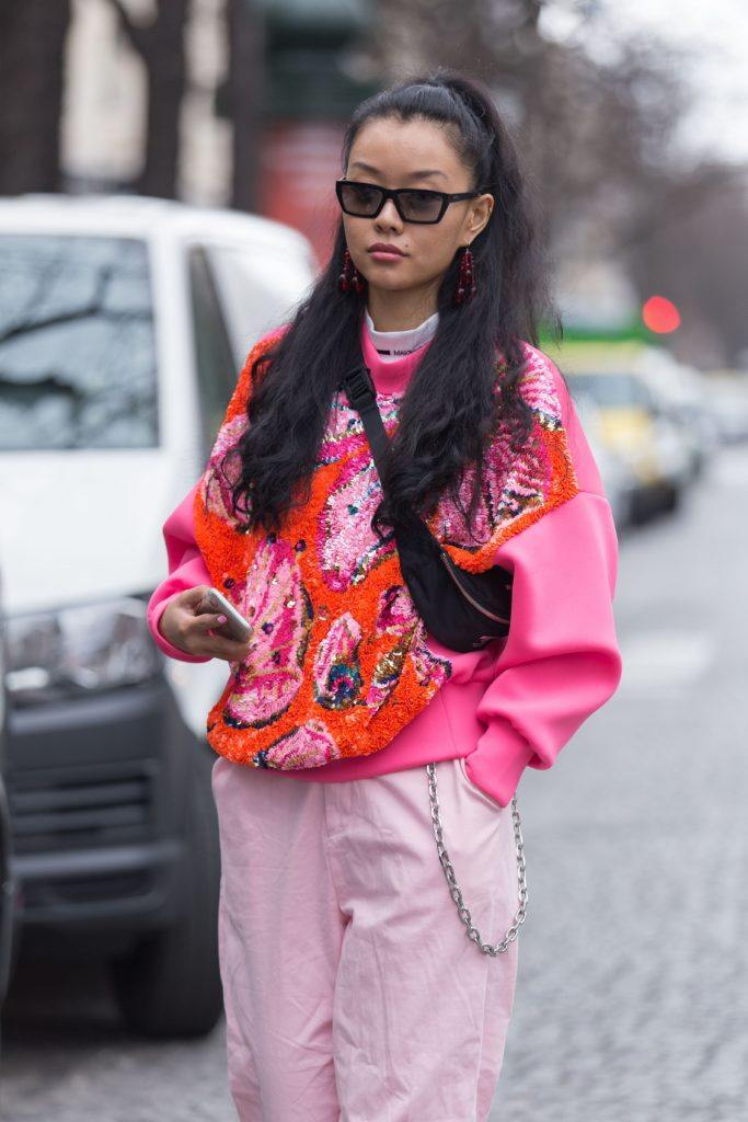 Paris Fashion Week Street Style: Woman with long brown hair in half-up, half-down ponytail wearing sunglasses