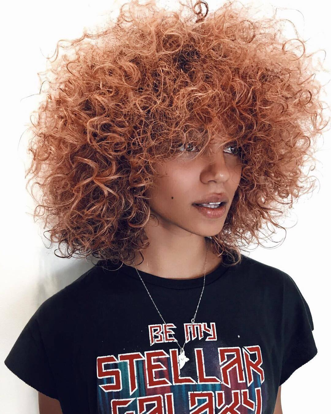 Woman with natural curly pumpkin spice hair