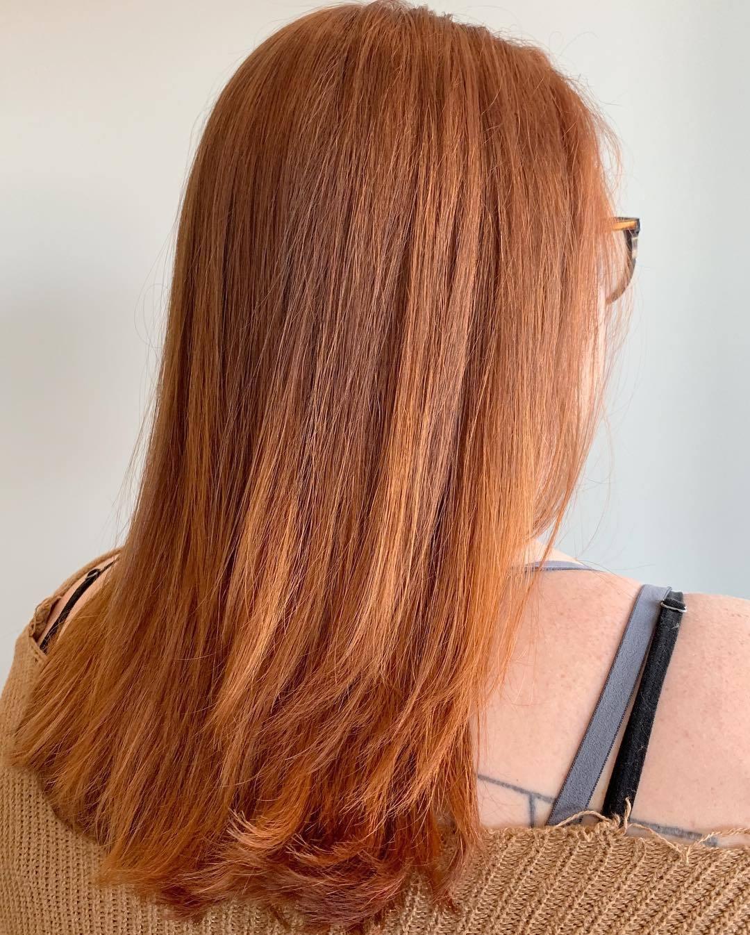 Woman with light pumpkin spice hair
