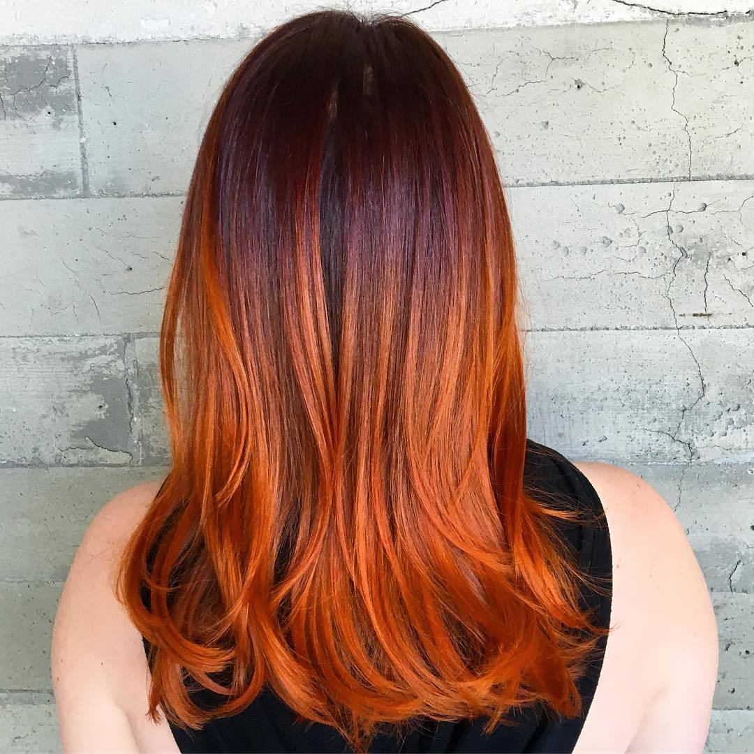 Woman with brown to vibrant pumpkin spice colour melted hair