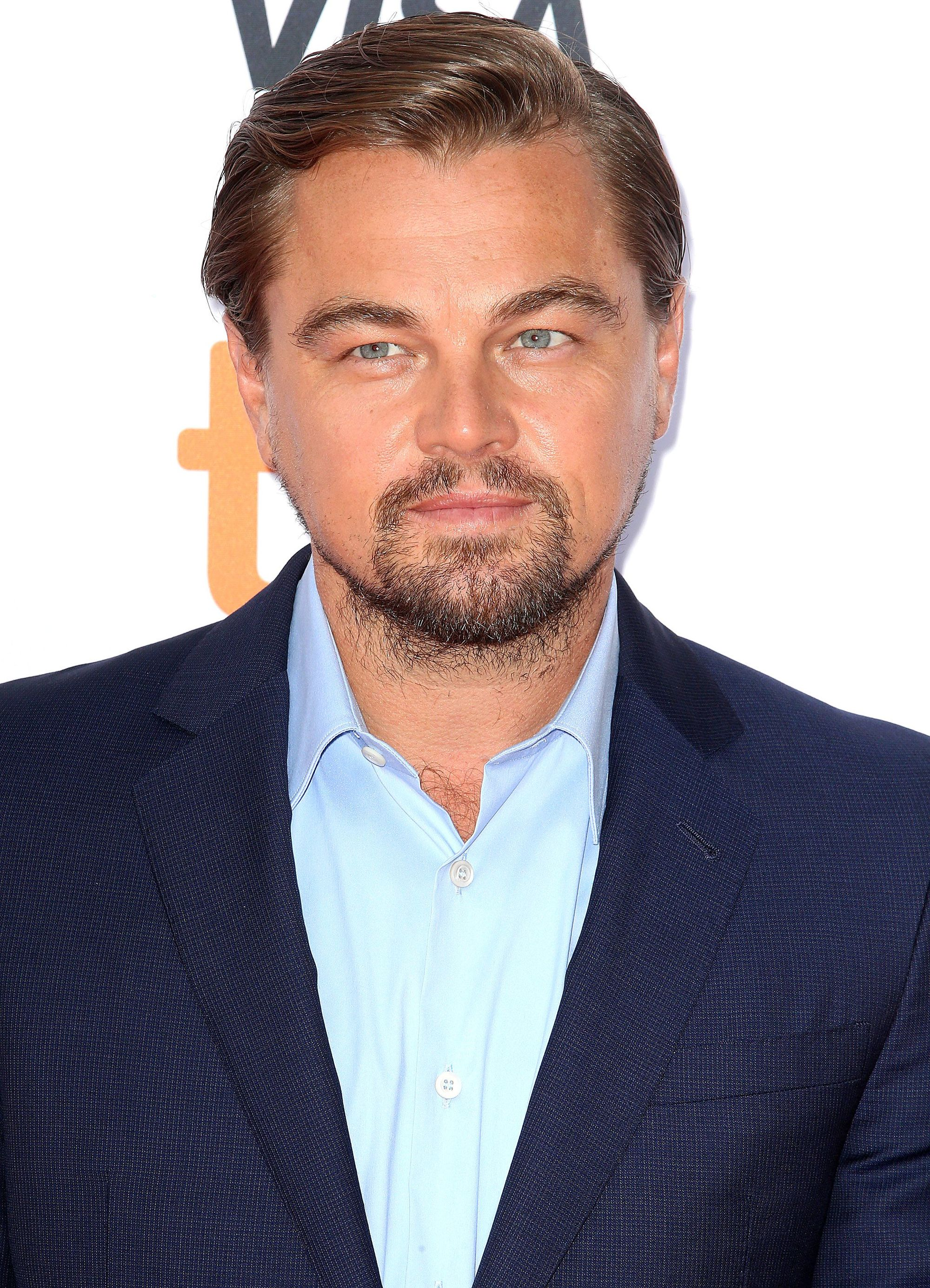 Hairstyles for men over 40: Photo of Leonardo DiCaprio with slicked over mid brown hair