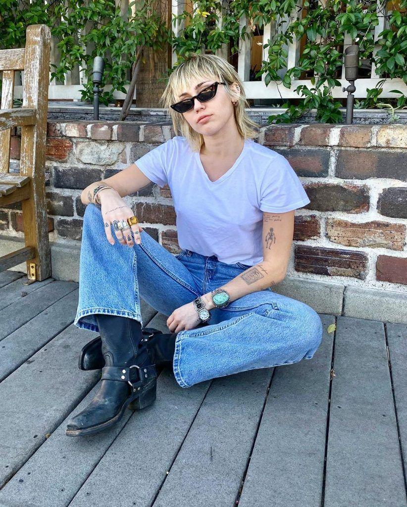 Miley Cyrus with short, choppy blonde shag haircut