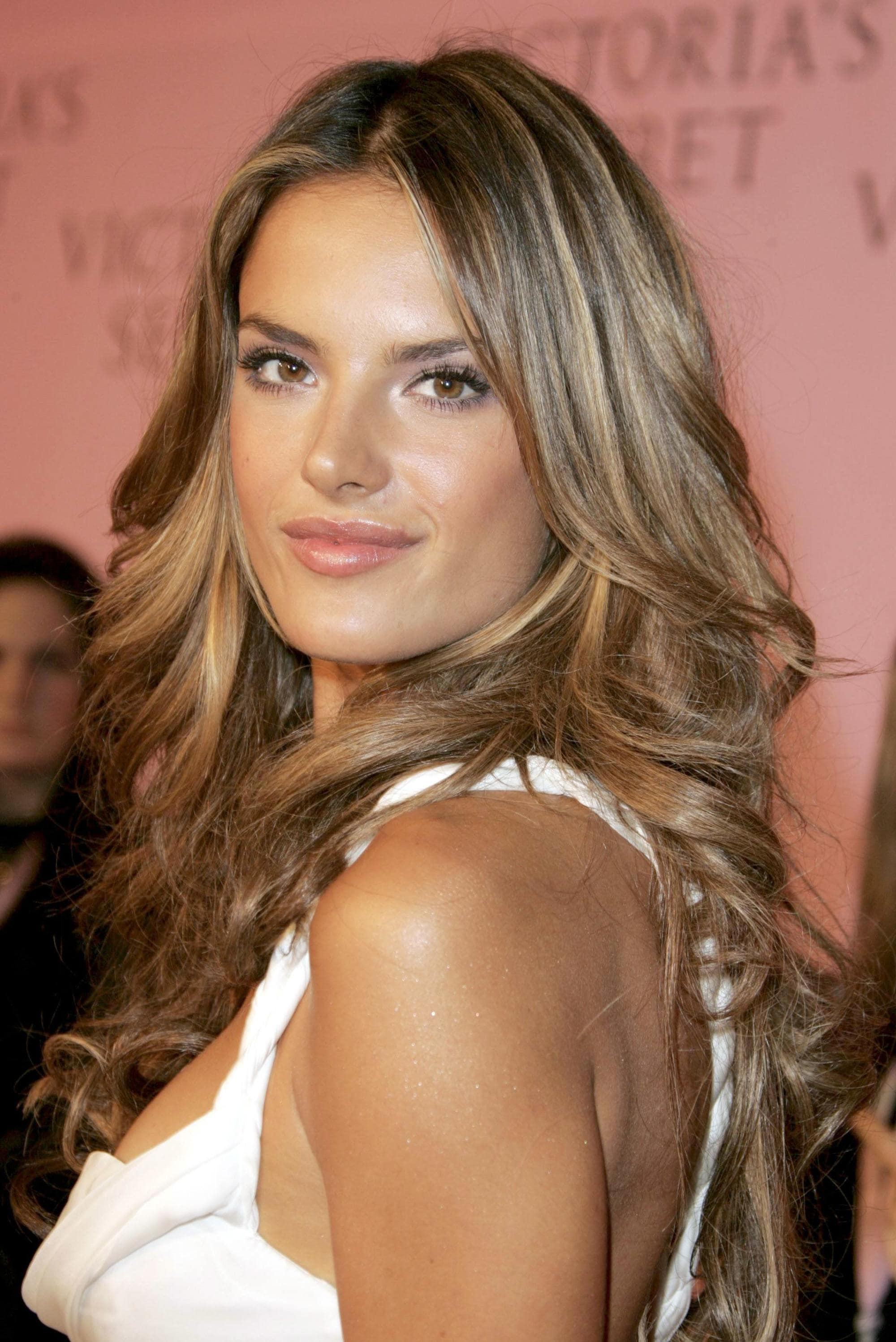 Brown hair with blonde highlights: Alessandra Ambrosio with her brunette highlighted hair styled in classic voluminous Victoria's Secret waves