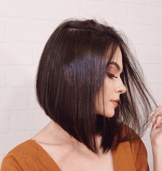 Brunette woman with a sleek angled bob
