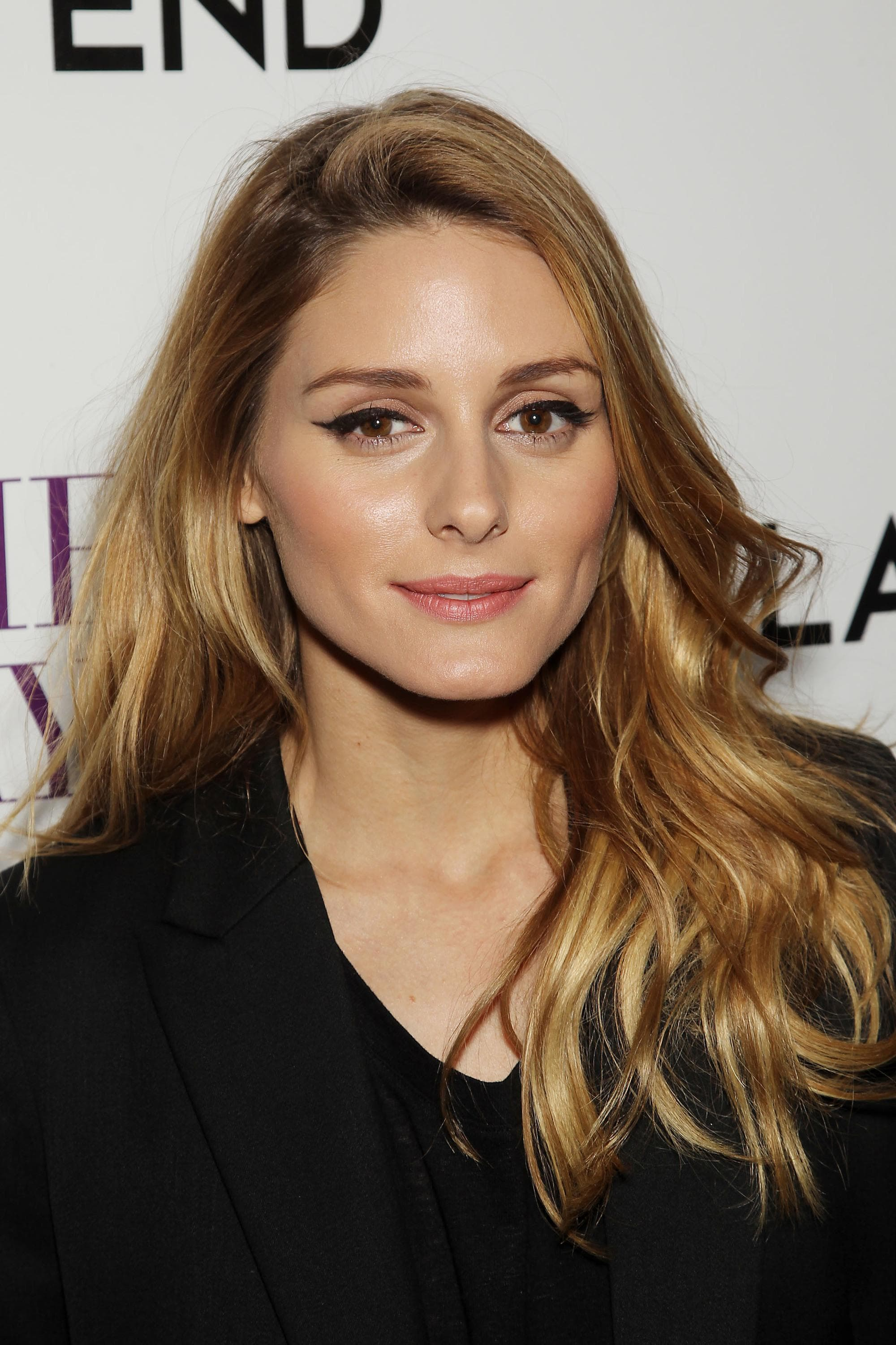 Brown hair with blonde highlights: Olivia Palermo with her bronde highlighted hair swept over one shoulder in loose waves