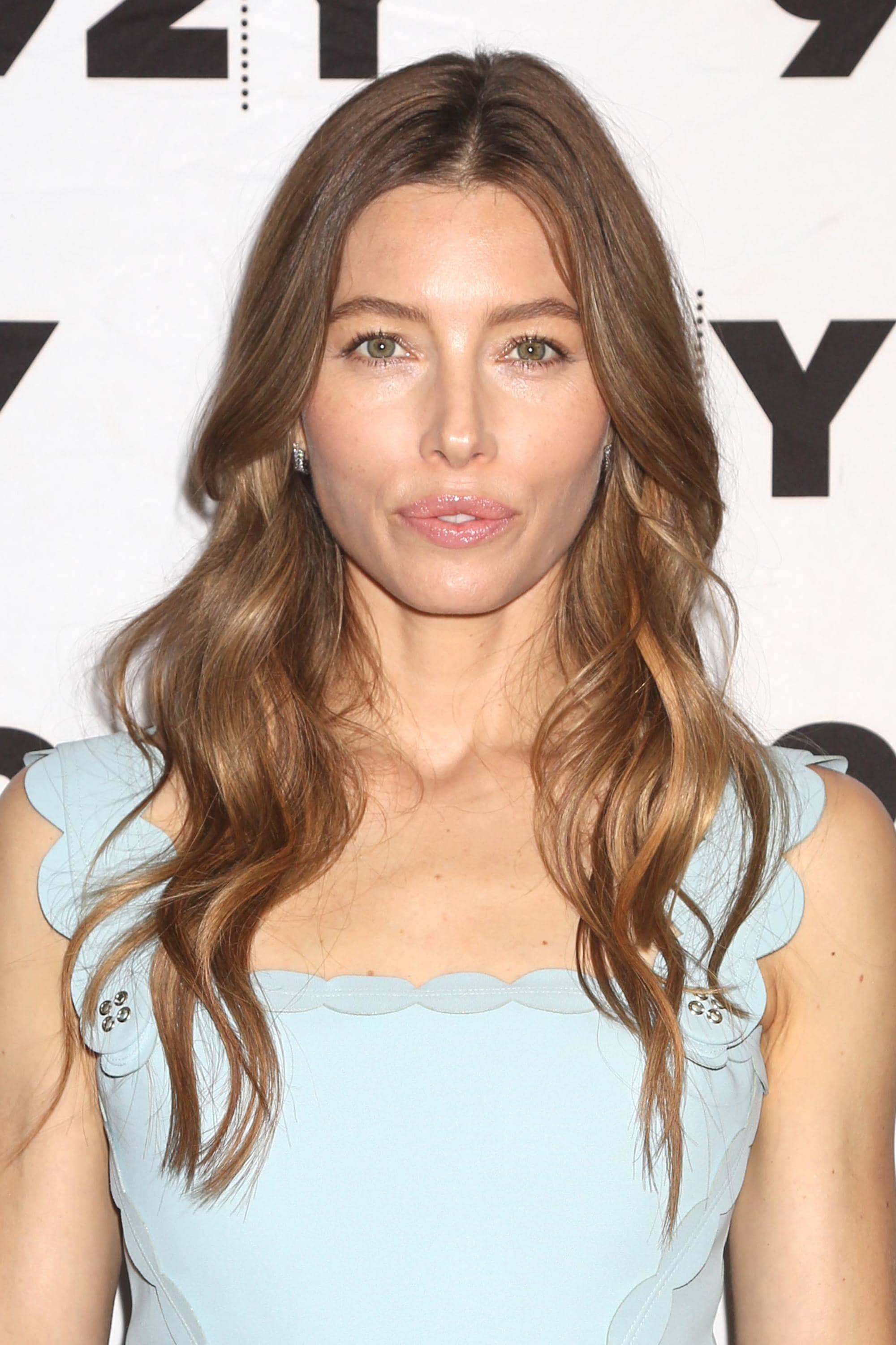 Brown hair with blonde highlights: Jessica Biel with long curled brown hair with highlights, wearing a pastel blue dress