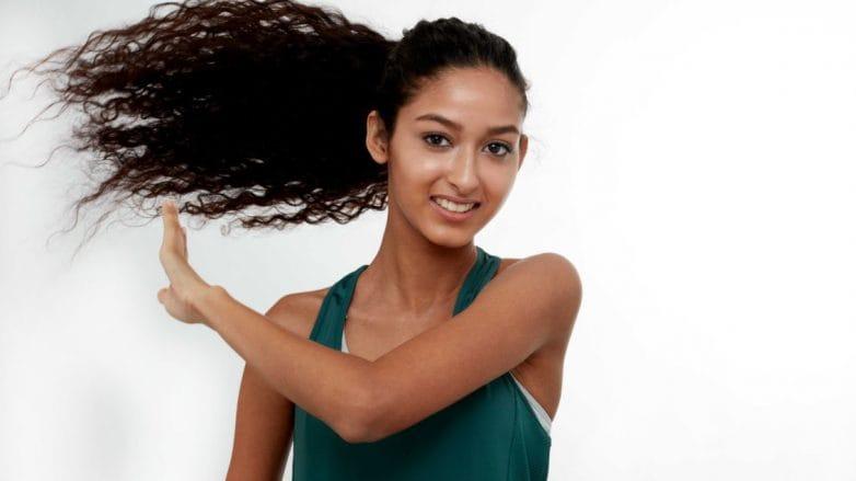 Woman swishing her ponytail