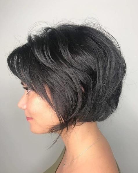 Woman with a dark brunette choppy bob haircut