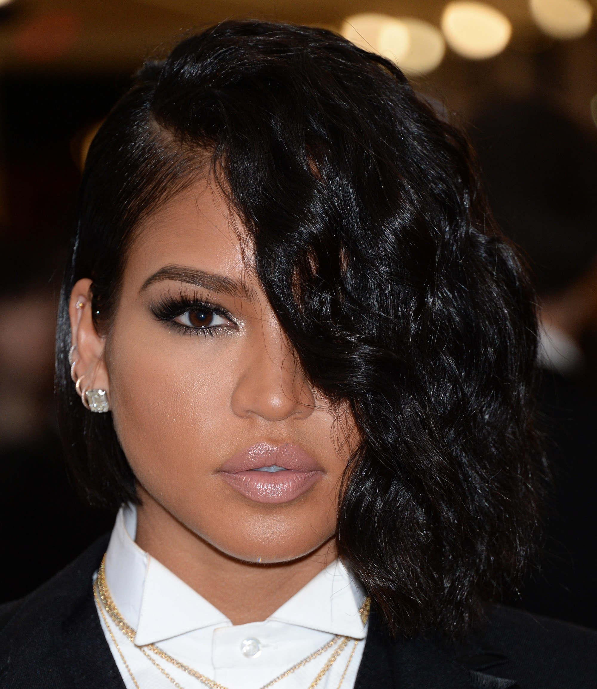 Bob hairstyles: Cassie Ventura with dark bob cut with long side swept fringe covering her eye on the red carpet