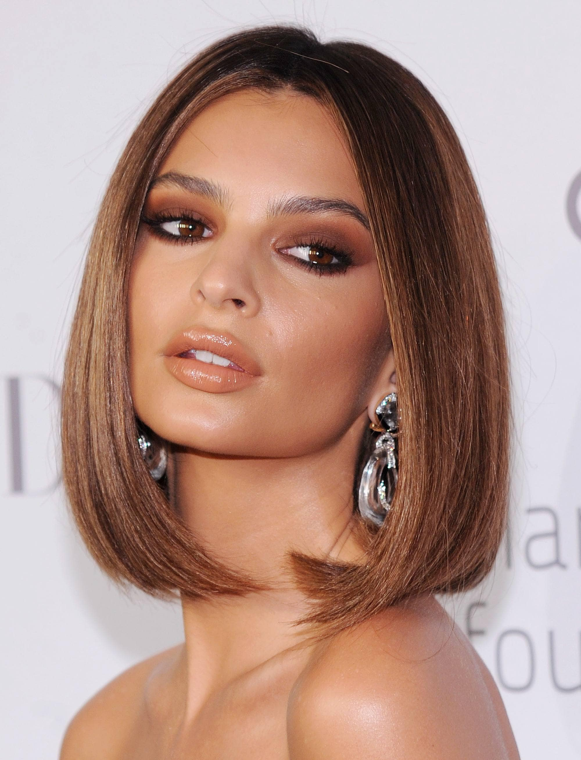 Celebrity bob hairstyles: Emily Ratajkowski with long caramel bob curled under, on the red carpet