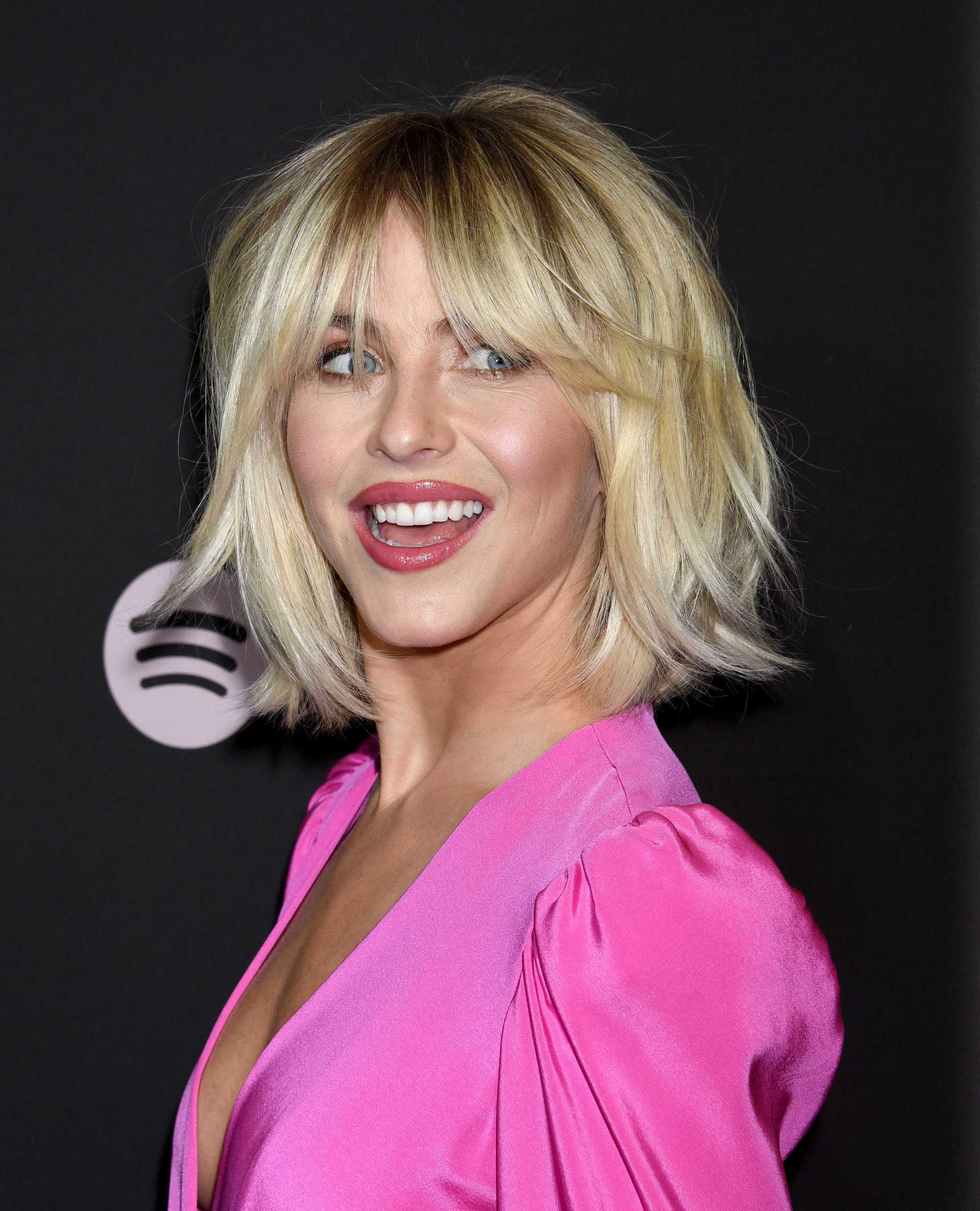 Julianne Hough on the red carpet with a shaggy golden blonde bob haircut wearing all pink