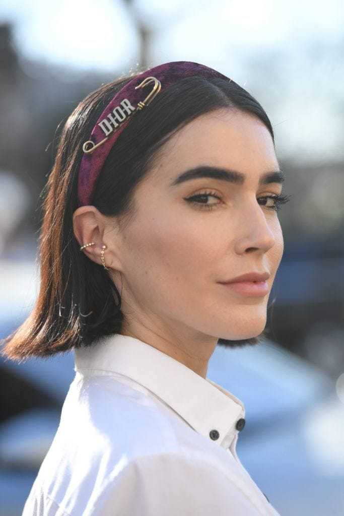 Bob hairstyles: Brittany Xavier with blunt bob cut, wearing Dior headband with white shirt