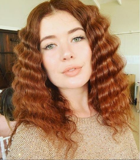 Woman with ginger crimped wavy hair