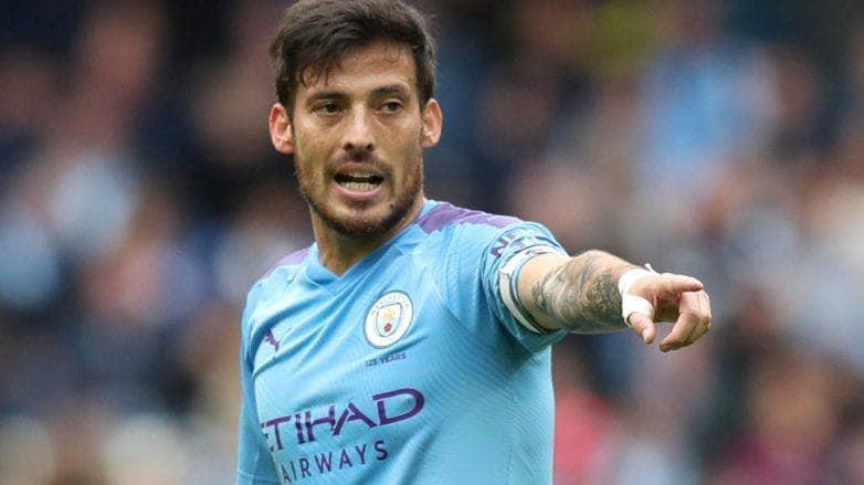 David Silva pointing and playing football
