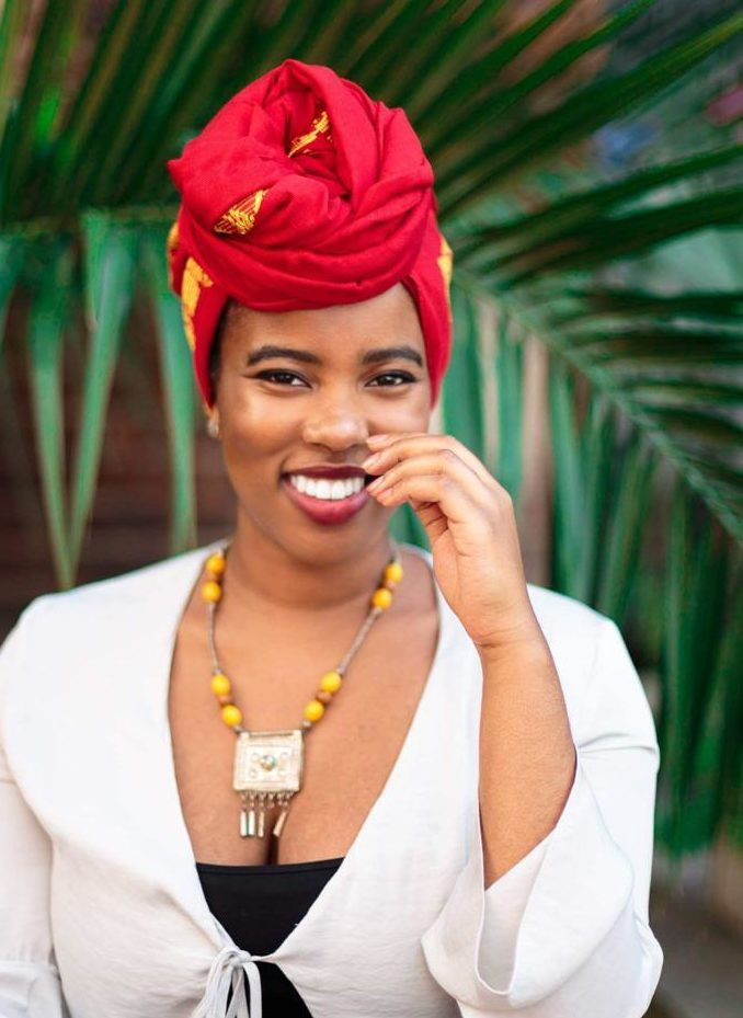 The Day I Went Natural: Shot of Dr. Alexandra Oti wearing a headwrap and posing outside