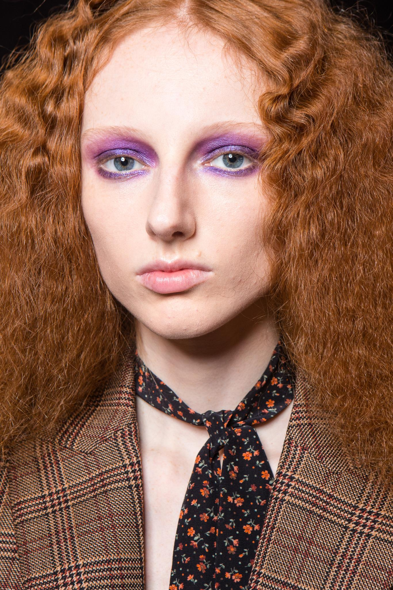 Woman with frizzy crimped ginger hair