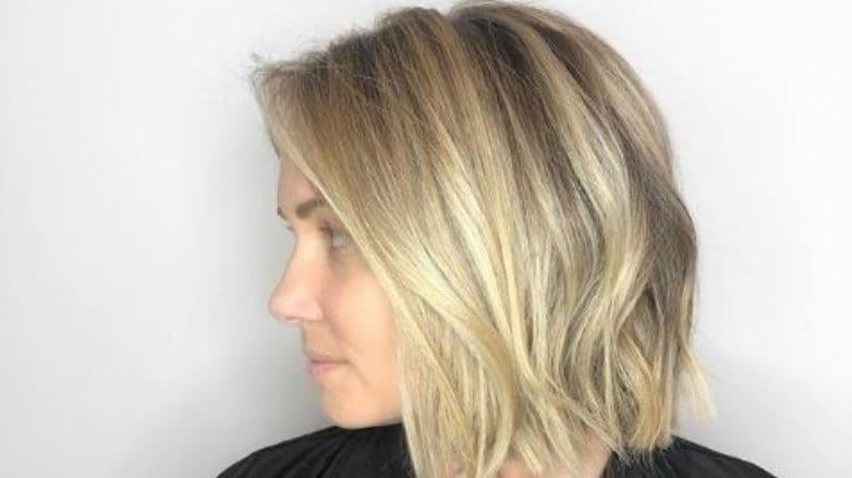Partial highlights: Woman with a blonde lob with highlights