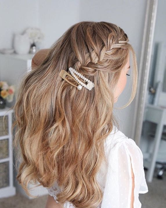 Blonde woman with long hair in a half-up fishtail braid