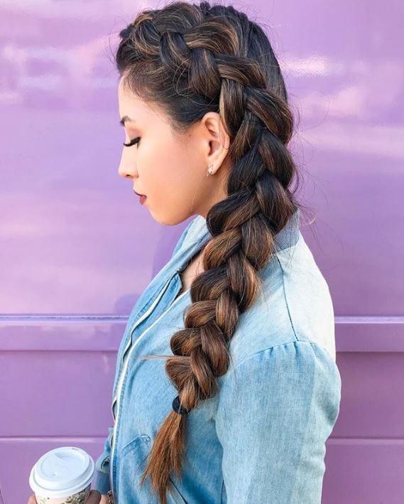 Brunette woman with long side dutch braid