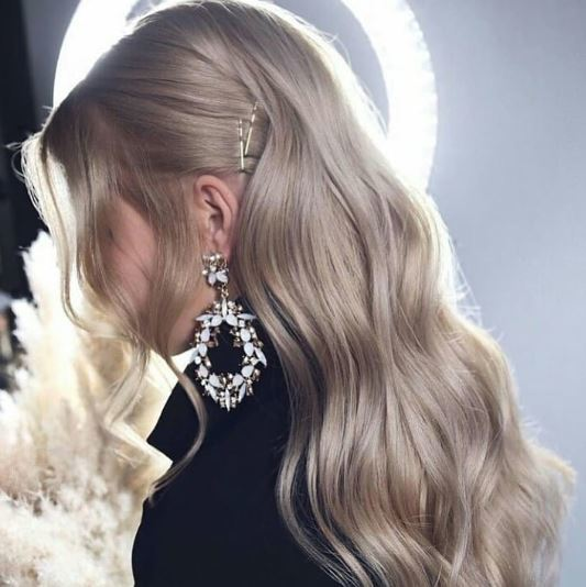 Woman with long wavy silver blonde hair