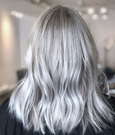 Woman with wavy silver blonde hair