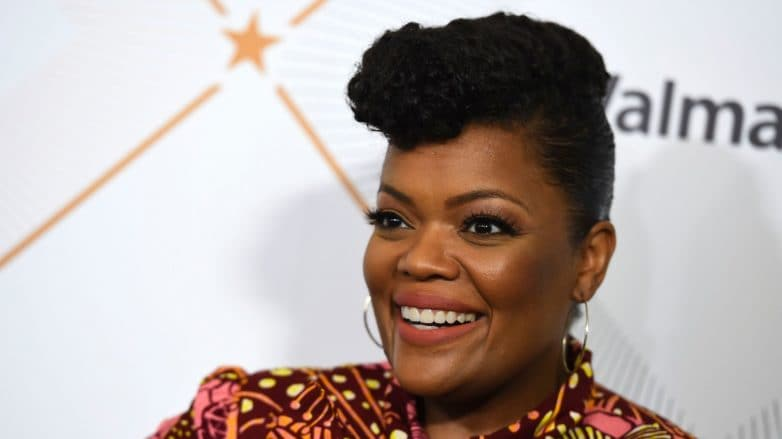 Actress Yvette Nicole Brown with natural hair in pompadour updo.