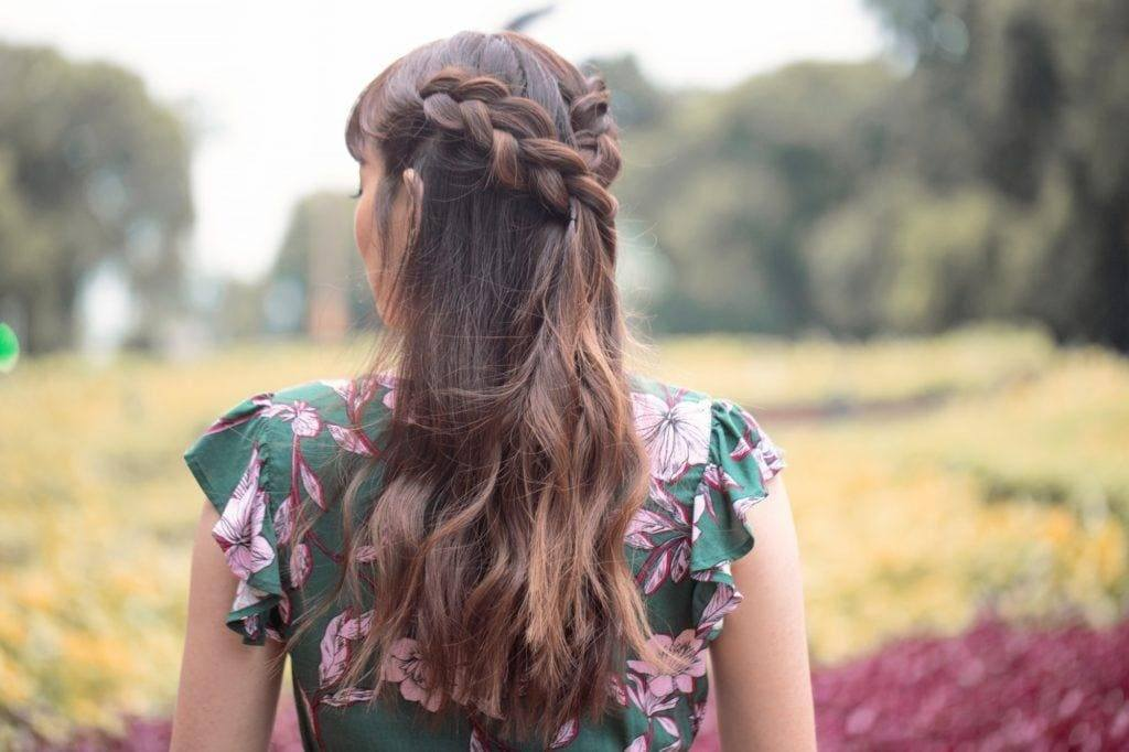 brunette woman with a half up dutch braid hairstyle