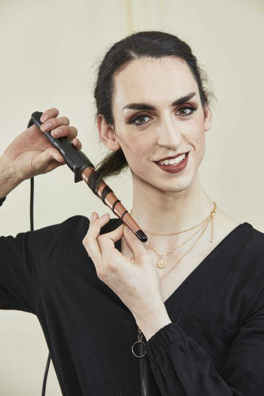 woman with sectioned hair curling her hair