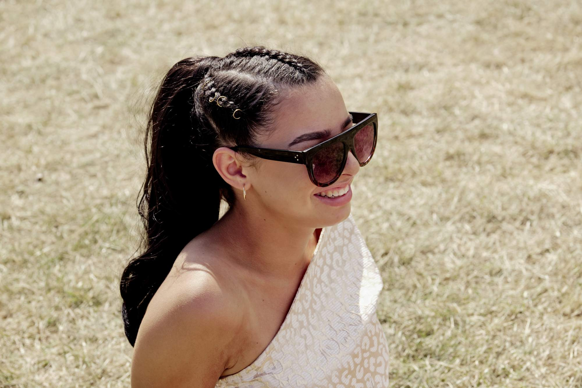 brunette with braided ponytail and hair rings