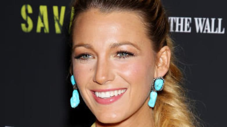 Blake Lively with long golden blonde hair in a fishtail ponytail braid.
