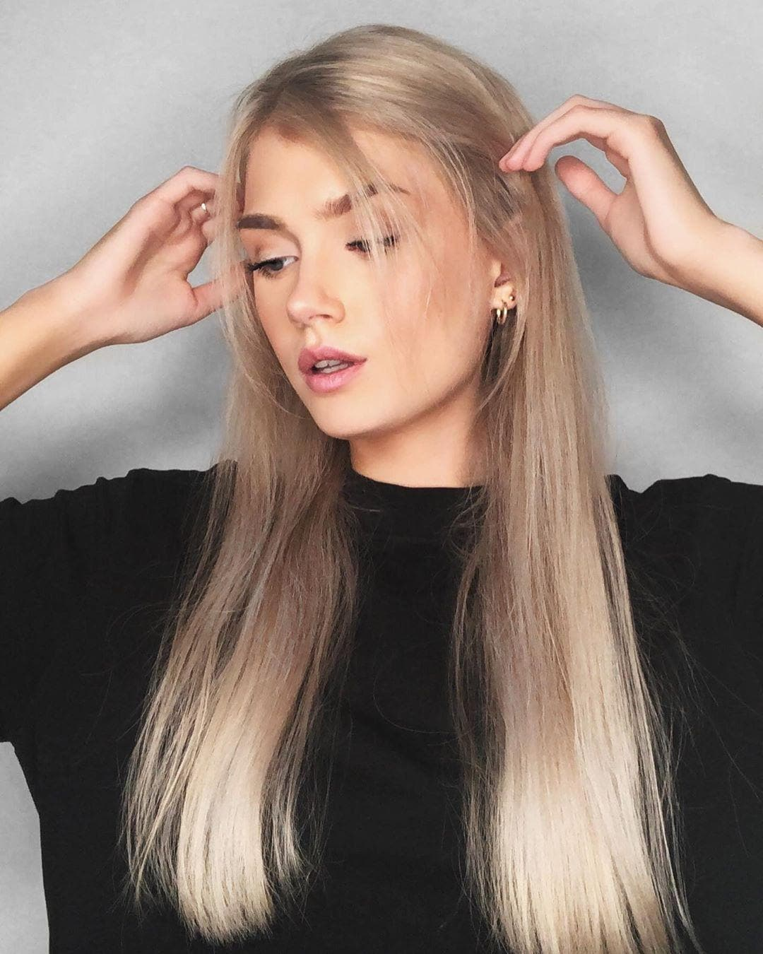 Woman with long straight champagne silver blonde hair