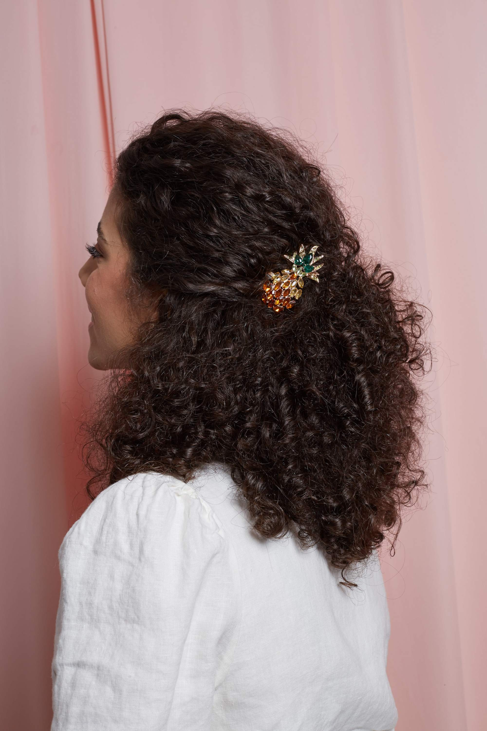 Naturally curly hair in half-up, half-down