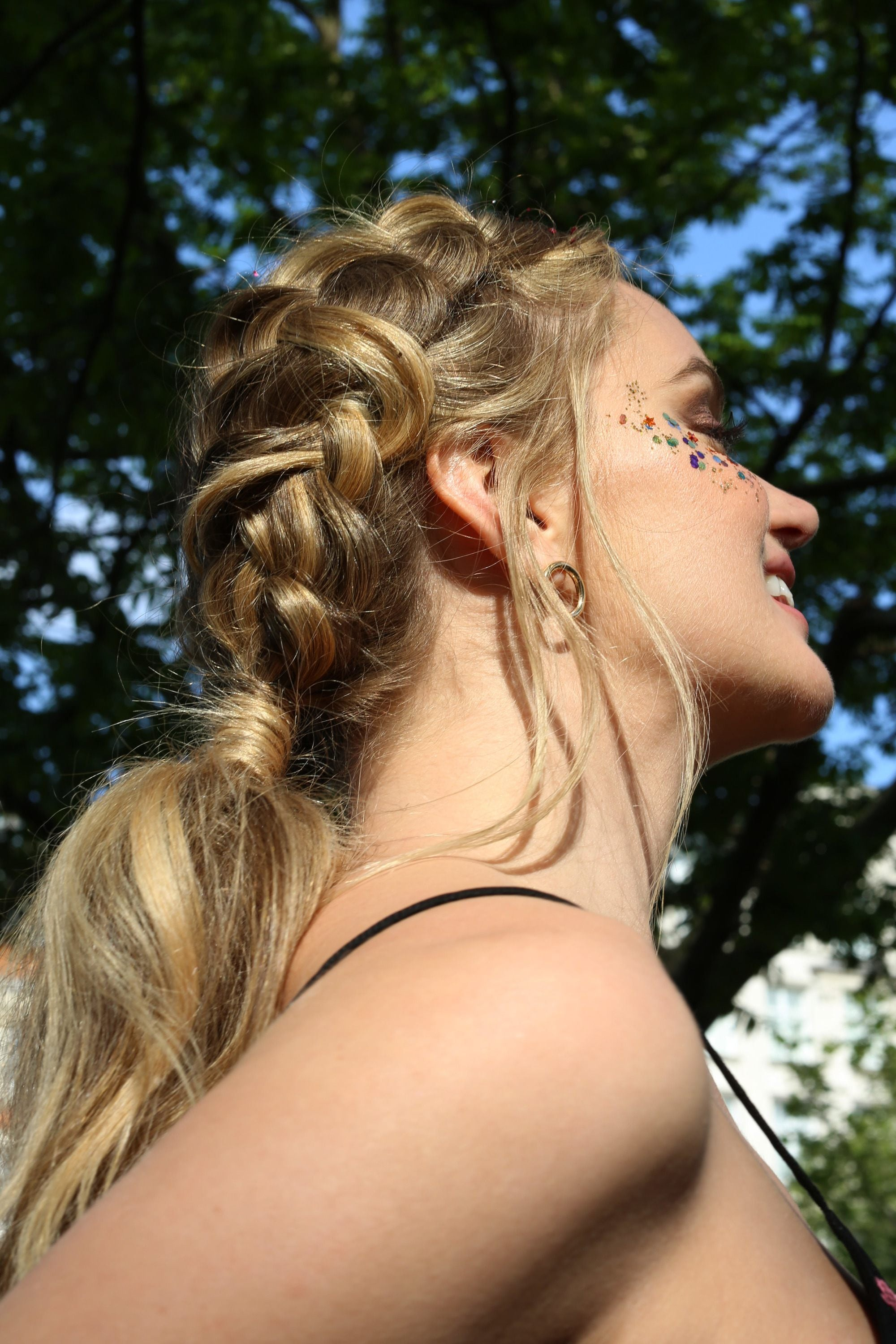 Blonde girl with a Dutch braid ponytail with glitter roots