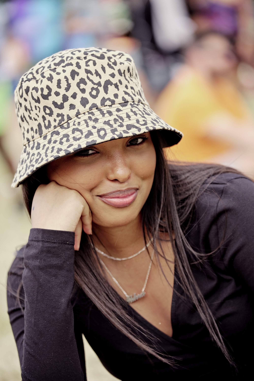 woman wearing an animal print bucket