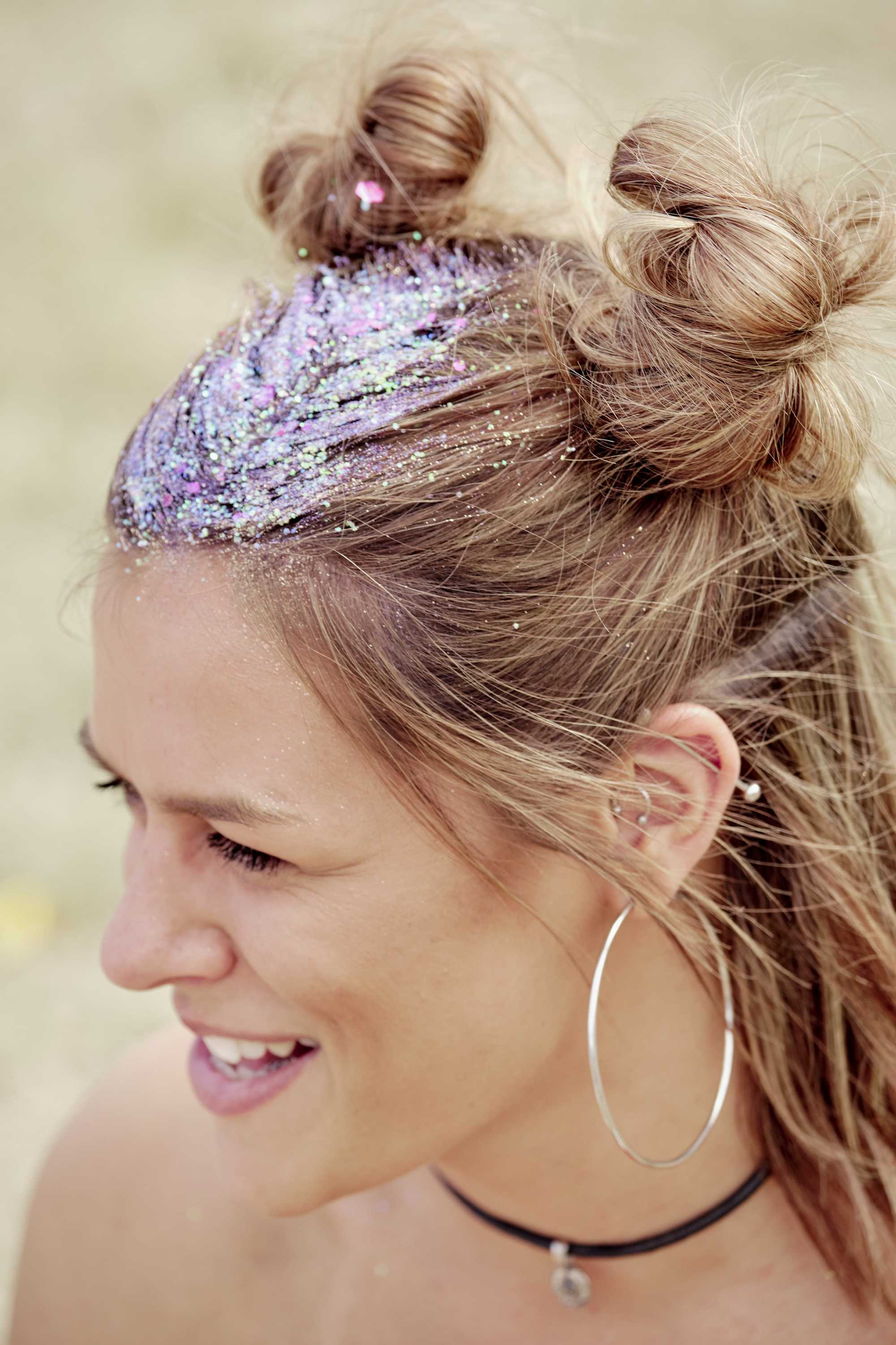 Brown blonde woman with glitter in her half-up buns