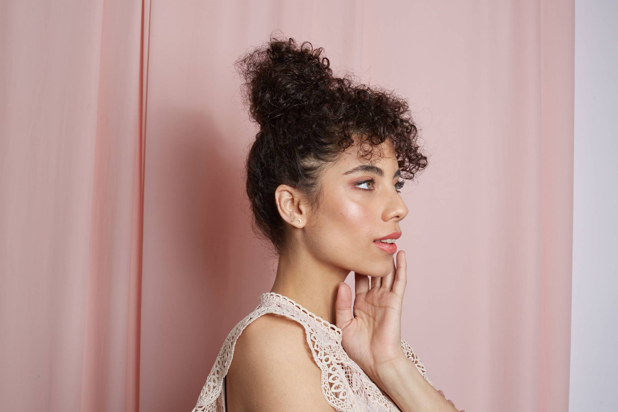 naturally curly brown hair in pineapple updo