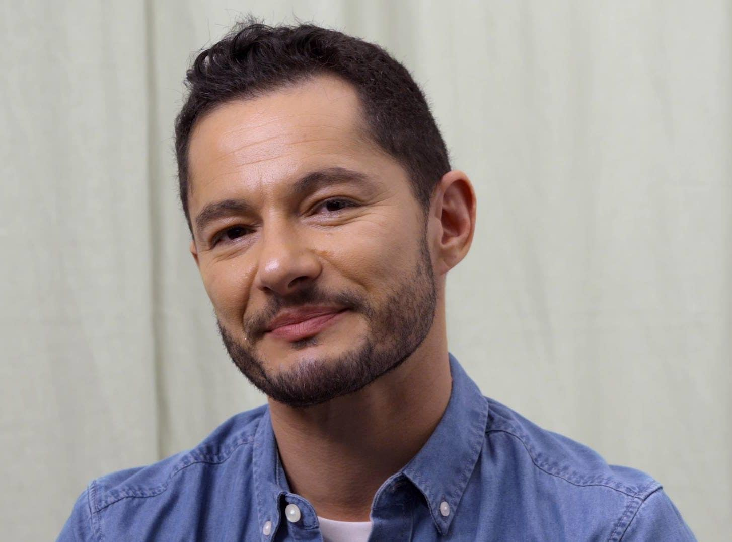 Jake Graf with short brown hair with small quiff wearing denim shirt