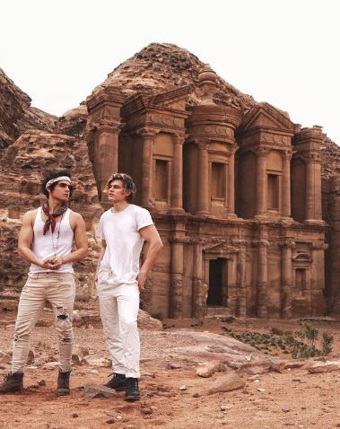 Troy Pes and Zander Hodgson outside monument in Jordan