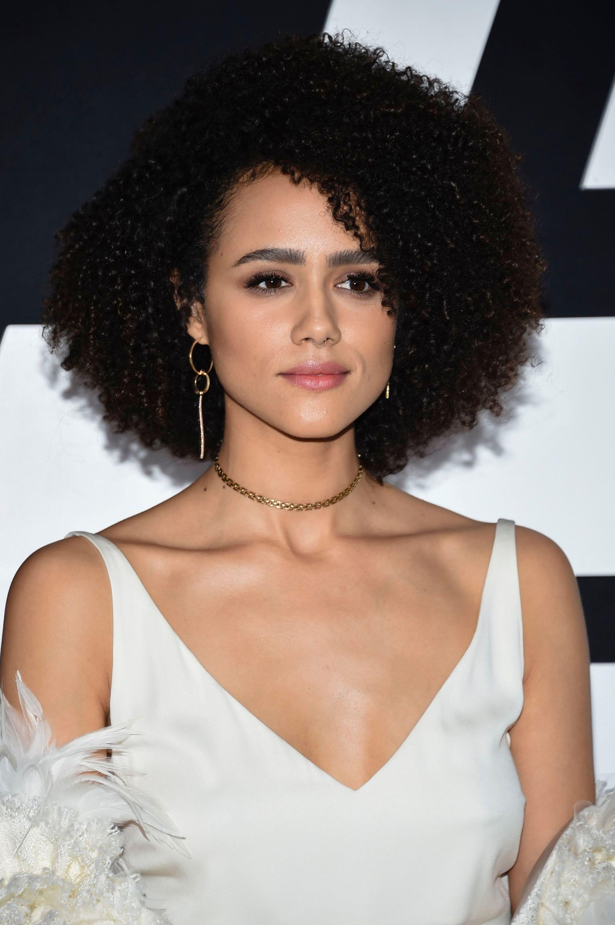 Nathalie Emmanuel with curly brown hair
