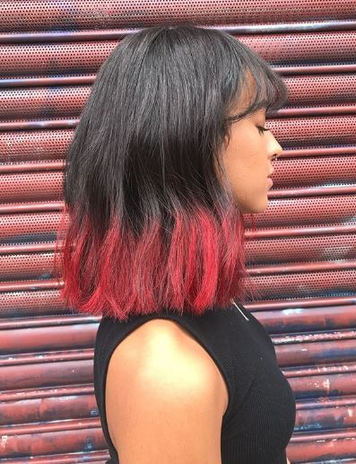 Woman with black and red ombre long bob