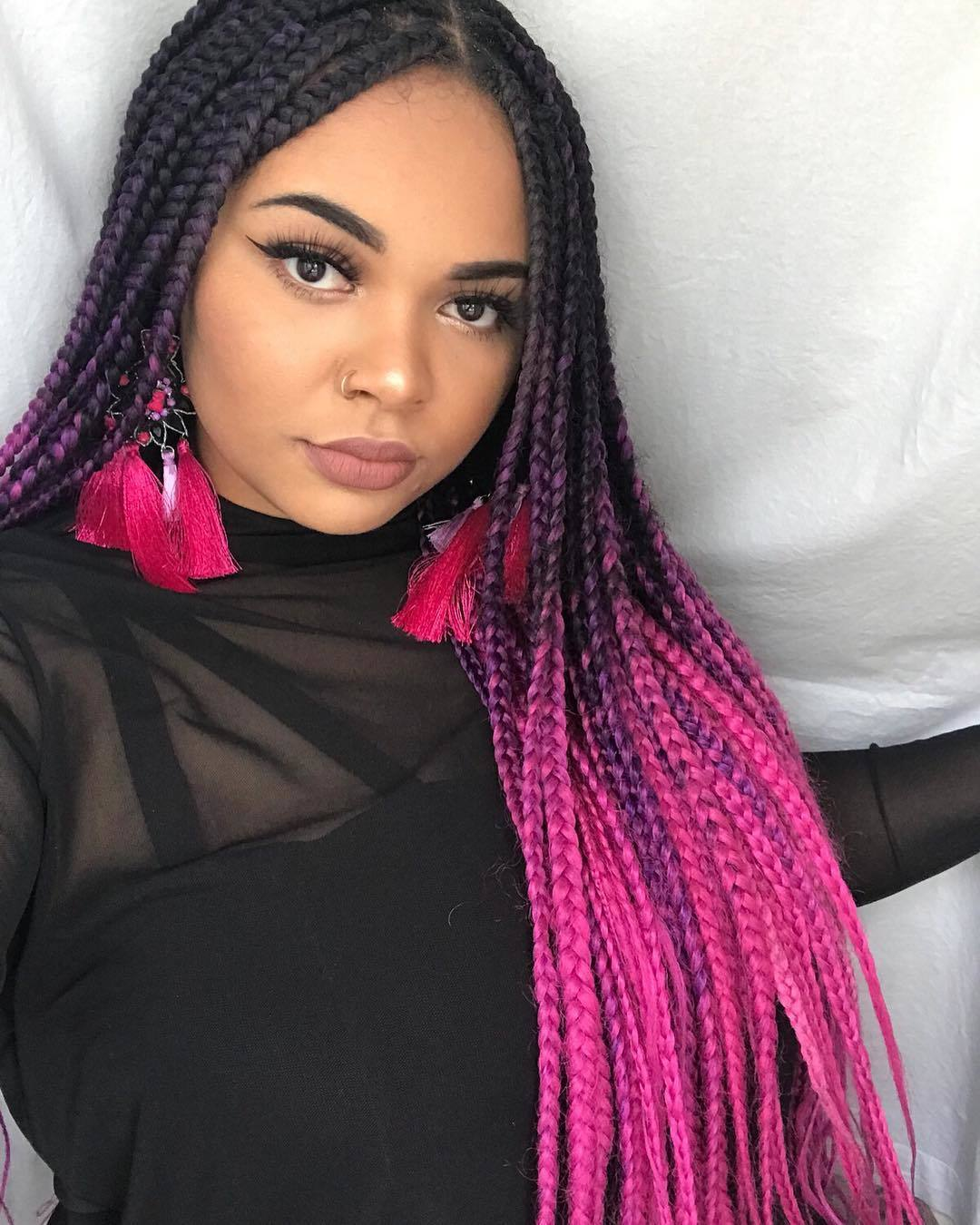woman with dark brown to neon pink box braids