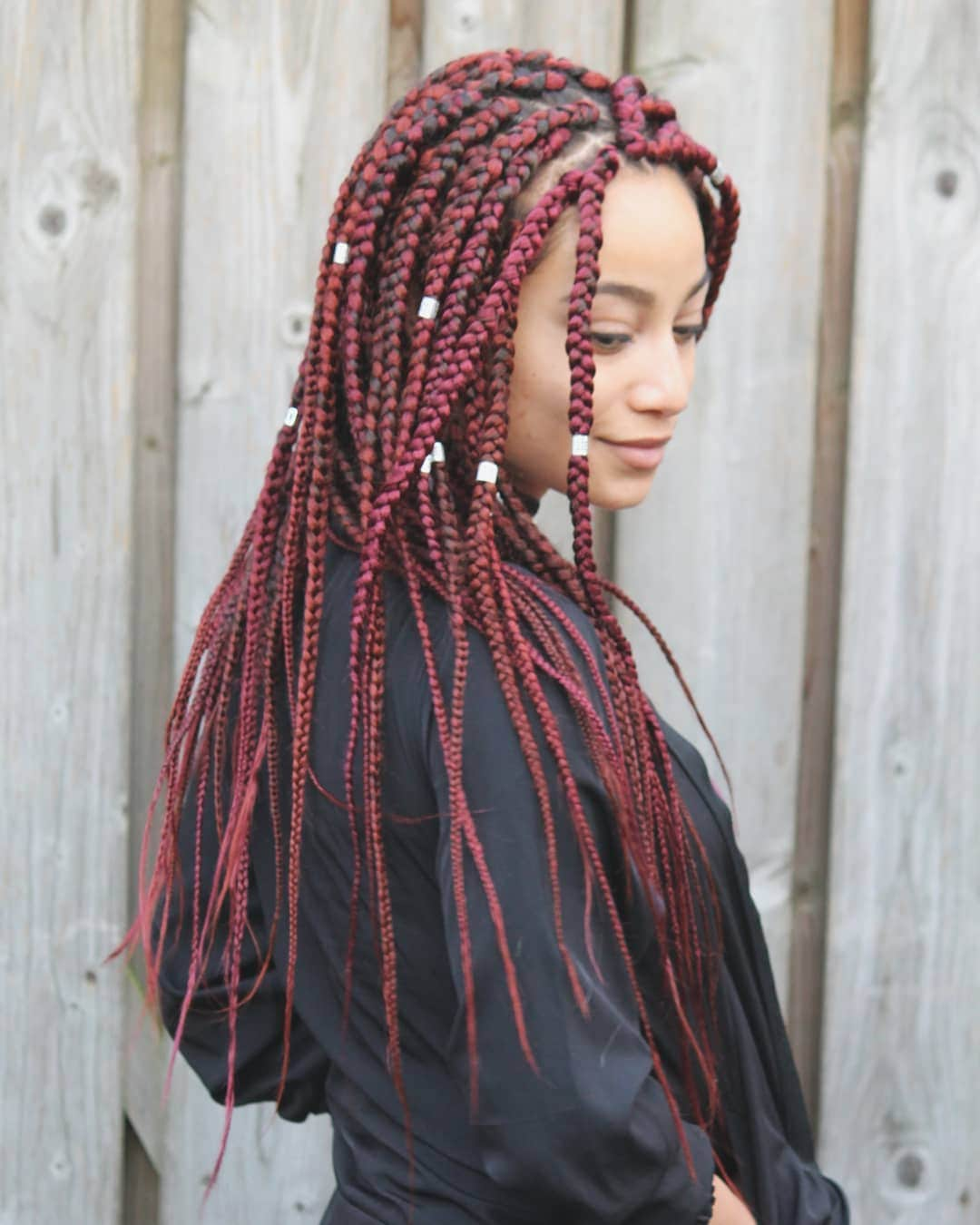woman with long red braids and hair cuffs in them